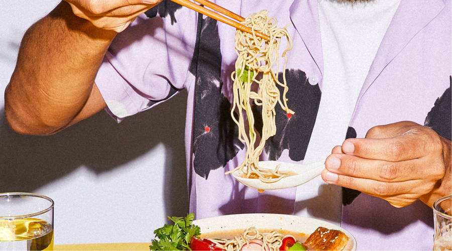 Man eating ramen noodles